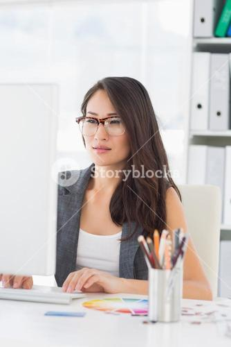 Concentrated woman using computer in office