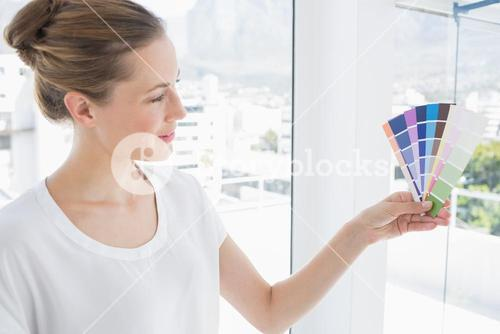 Portrait of a photo editor holding colors