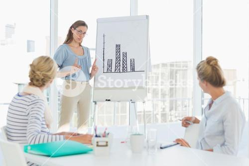 Casual business people in office at presentation