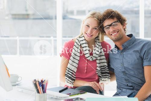 Portrait of a smiling casual business couple