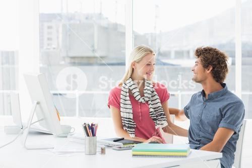 Casual business couple in a bright office