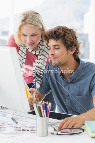 Casual couple using computer
