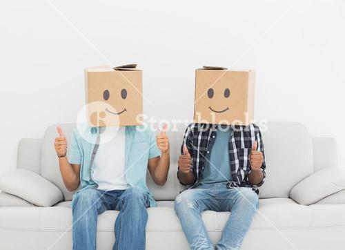 Men with happy smiley boxes over faces gesturing thumbs up
