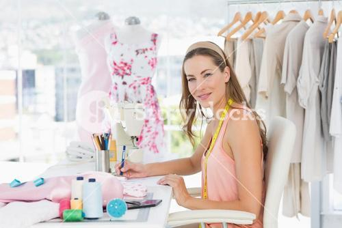 Portrait of a female fashion designer working on her designs