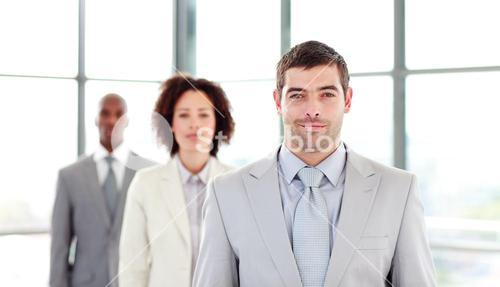 Serious businessman leading his colleagues
