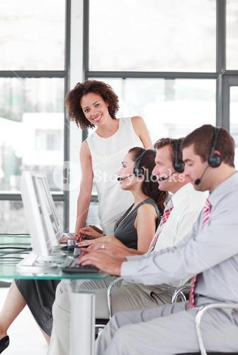 Leader managing her team in a call center