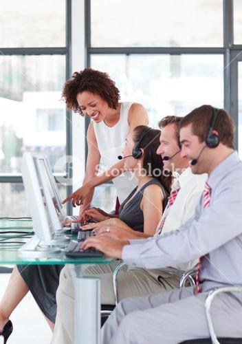 Female leader managing he team in a call center