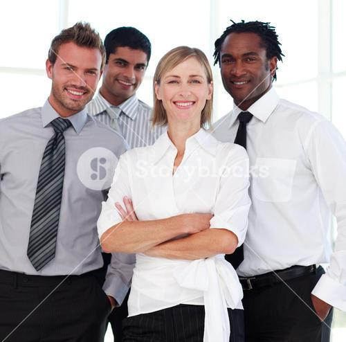 Business team smiling at the camera