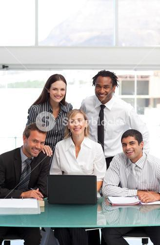 Smiling Business team working together with a laptop