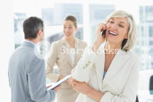 Businesswoman on call with colleagues discussing at office