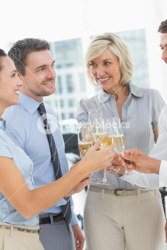 Business team toasting with champagne in office
