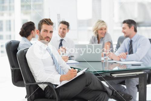 Businessman with colleagues discussing in office