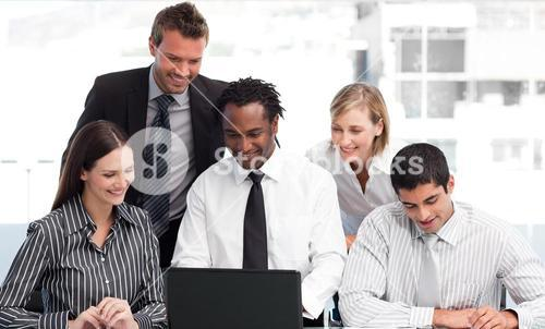 Business team working with a laptop