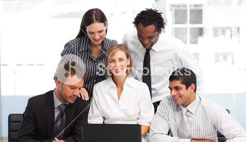 Business people using a laptop in an office
