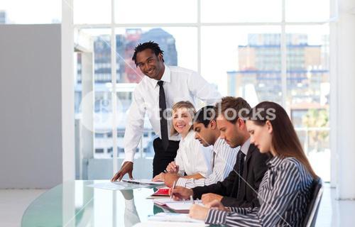 Leadership working with his team