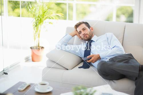 Well dressed man watching tv in the living room