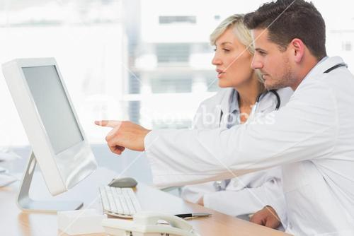 Doctors using computer at medical office