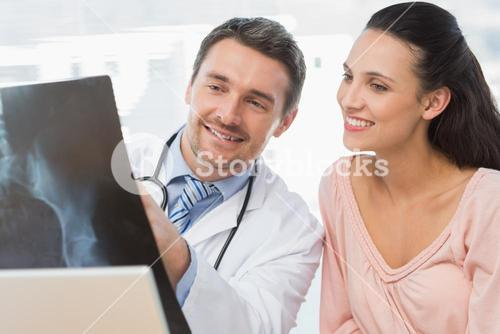 Doctor explaining xray report to a smiling patient