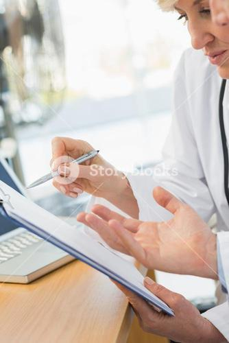 Closeup mid section of two doctors in meeting