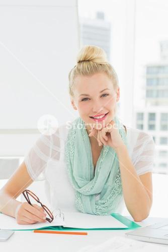 Portrait of a casual young woman with catalog
