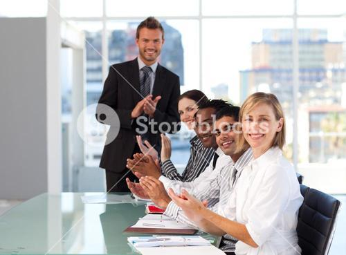 Business team clapping at the end of a presentation