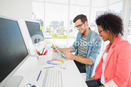 Casual young couple working on computer
