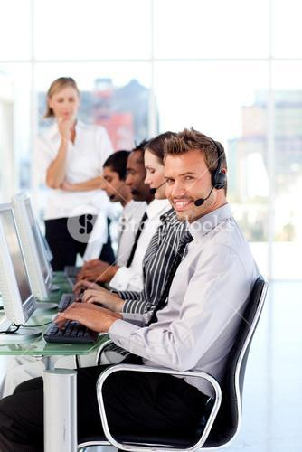 Attractive female leader managingher team in a call center