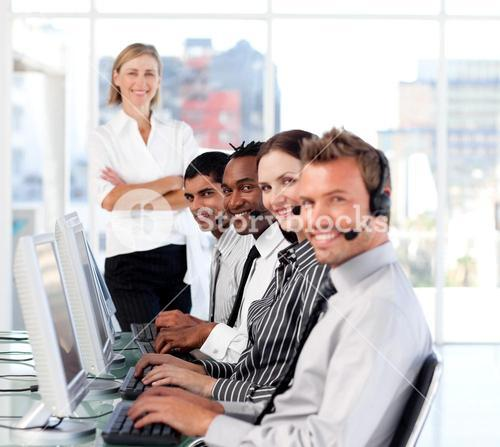 Radiant female leader managingher team in a call center