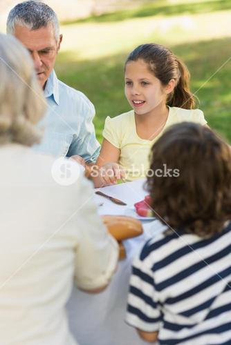 Family dining at outdoor table