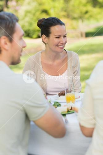 Couple dining at outdoor table
