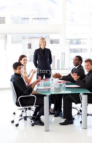 Businesspeople clapping in a presentation