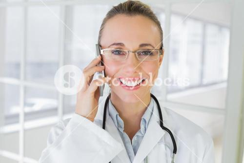 Closeup of a female doctor using mobile phone