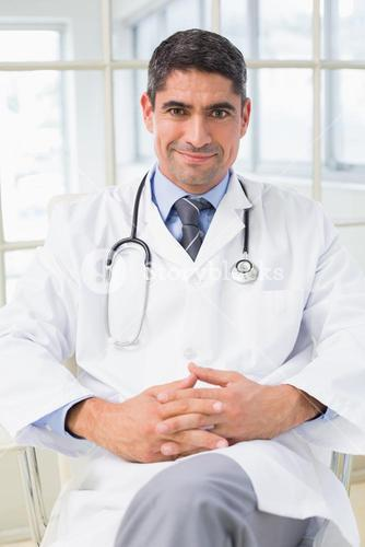 Portrait of a smiling male doctor in hospital