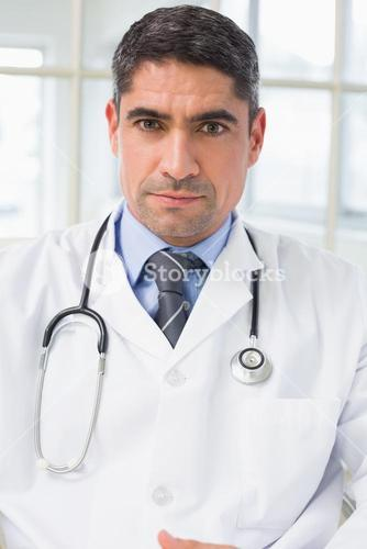 Portrait of a serious male doctor