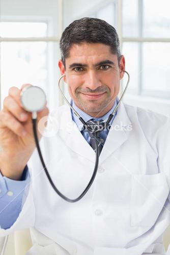 Confidence male doctor holding stethoscope