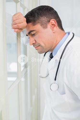 Side view of a thoughtful male doctor