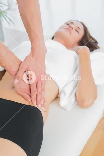 Closeup of a physiotherapist massaging womans body