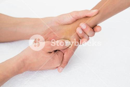 Doctor examining a female patients hand