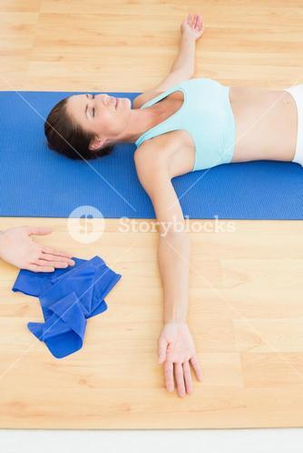 Woman relaxing with eyes closed at the hospital gym