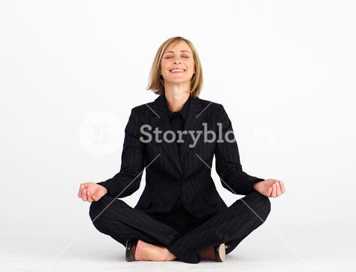Mature businesswoman doing meditation exercises
