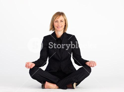 Businesswoman doing yoga exercises