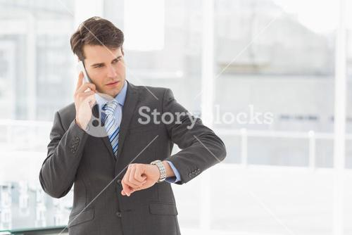 Businessman checking the time on the phone
