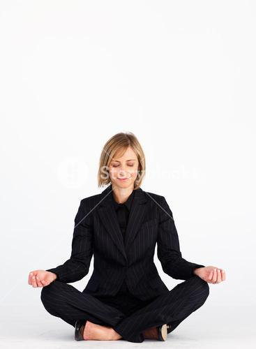 Businesswoman doing yoga with copyspace