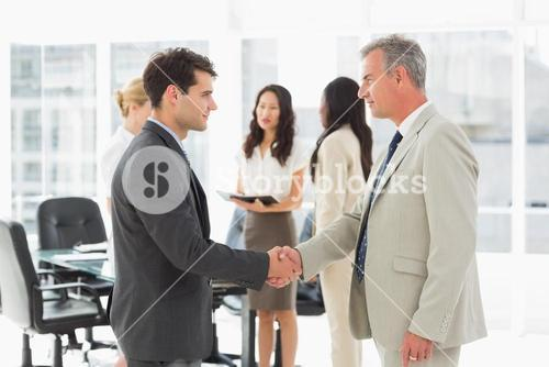 Businessmen meeting and shaking hands