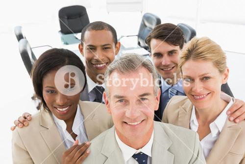 Diverse business team smiling up at camera