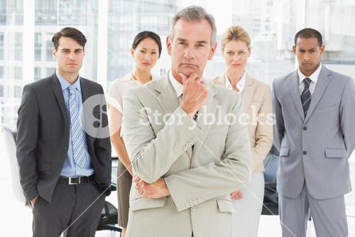 Diverse business team looking at camera