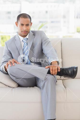 Serious businessman on couch