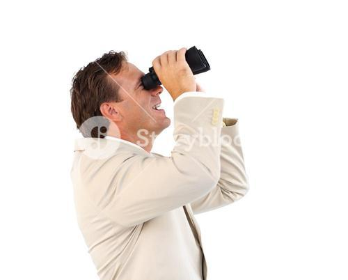 Handsome businessman manager searching for something with binoculars
