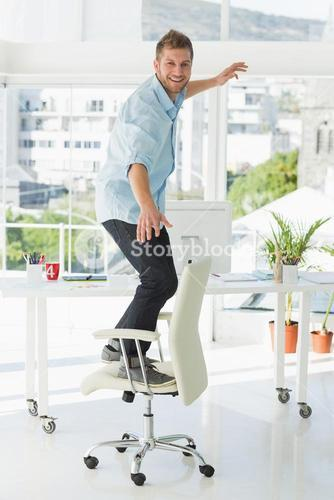 Designer surfing on his office chair