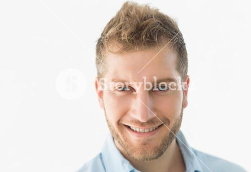 Confident young man smiling at camera